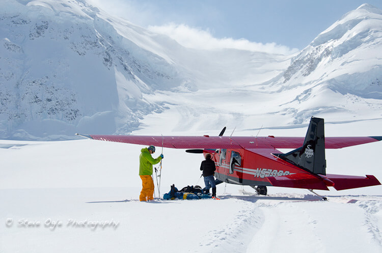 Ski plane landing for climbing team on Mt. Fairweather.